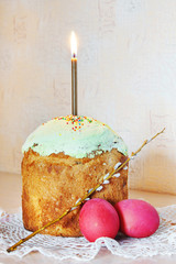 Orthodox Christian Easter still life with red eggs and a cake