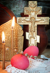 Orthodox Christian Easter still life with eggs and metal cross