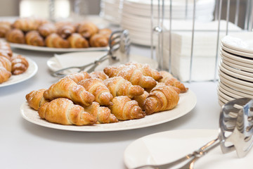 croissant and utensils