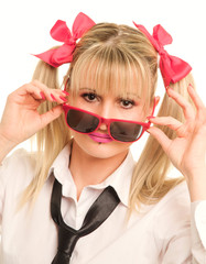 Young girl with pigtails glasses and ties