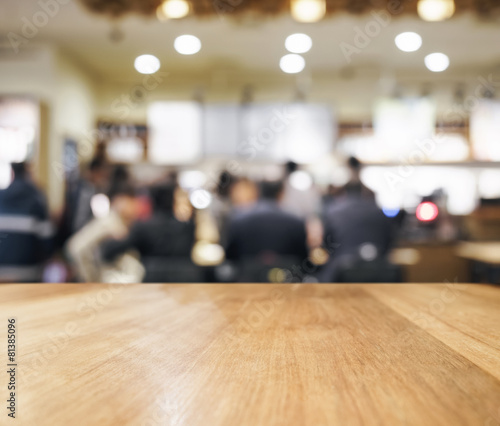 Table top with blurred Bar with people interior background - 81385096