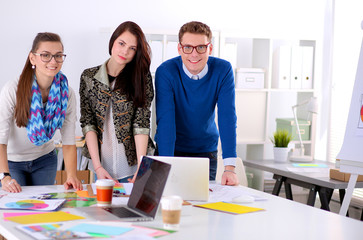 Young business people standing at office near desk