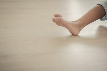 Feet of girl on wooen floor.