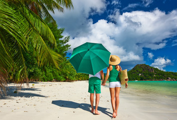Couple in green on a beach at Seychelles