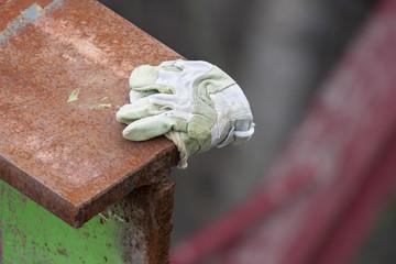 Cut Rusty Metal And Glove