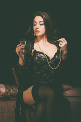 Sexy Woman in Lingerie Holding a Glass of Wine