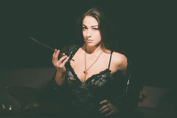 Seductive Woman in Lingerie Holding Cigarette Pipe