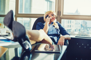 Young businesswoman relaxed at work