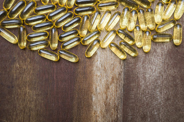 fish oil capsule on wooden background