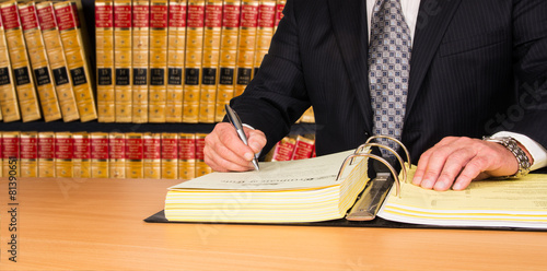 Lawyer signing legal documents - 81390651