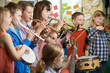 Leinwanddruck Bild - Group Of Students Playing In School Orchestra Together