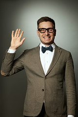 Nerd in eyeglasses and bow tie says Hello