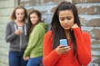Leinwandbild Motiv Teenage Girl Being Bullied By Text Message
