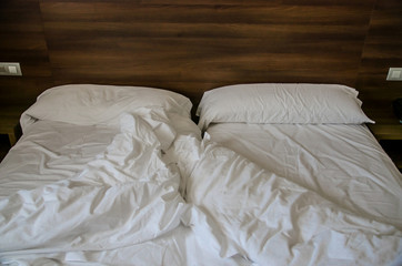 Empty messy bed