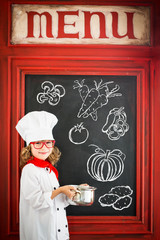Child chef cook. Restaurant business concept