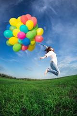 Woman jumping with toy balloons