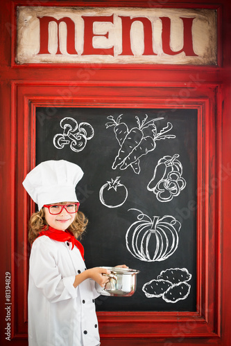 Child chef cook. Restaurant business concept - 81394829