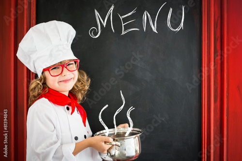 Child chef cook. Restaurant business concept - 81394843
