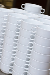Stack of white soup bowls