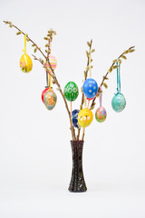 painted easter eggs hung on a lambs tails