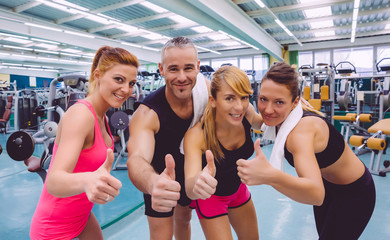 Friends whit thumbs up smiling after a training day