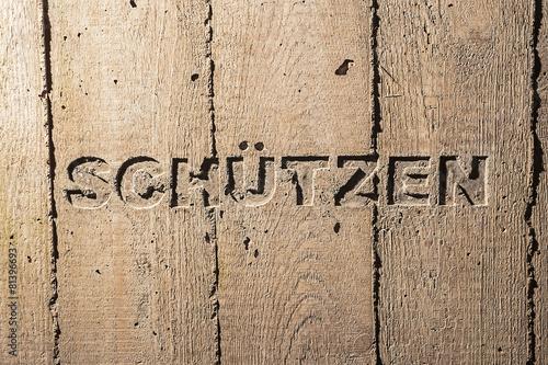 "Leinwanddruck Bild Impulswort ""SCHUETZEN"" am Brunnen im Klarahof Kollegium Stans"