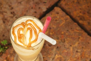 Caramel Latte in a glass at the garden