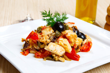 Swordish with tomatoes, capers and olives, sicilian recipe