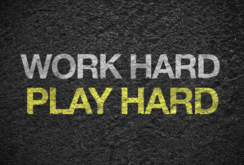 """Inspiration quote : """" Work hard play hard """" on black rough stone"""