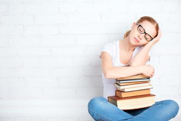 tired student girl asleep hugging books