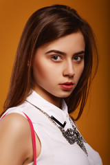 Portrait beauty girl on yellow background