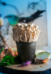 mushrooms enoki on a blurred background