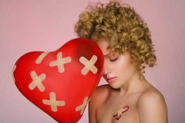 Unhappy woman with patches on the body and balloon