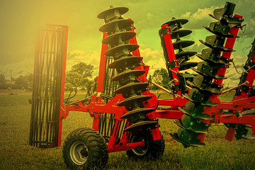 Agricultural equipment in sunset light. Detail 4