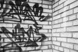 Abstract graffiti fragment on gray brick wal
