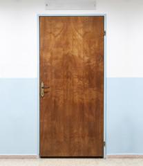 Closed old wooden office door, background texture