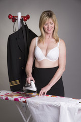 Pilot ironing her uniform shirt