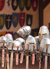An Assortment of Helmets, Shields and Swords