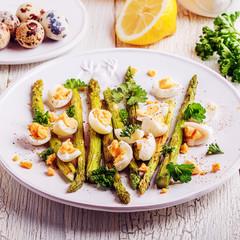 Grilled asparagus with quail eggs