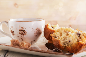 Vanilla muffins and a cup of coffee