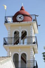 Yellow the town hall with clock in Moraitika. Corfu. Greece.
