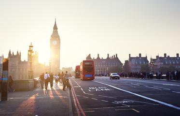 people on Westminster Bridge at sunset, London, UK