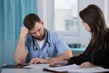 Physician talking with lawyer