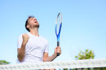 Tennis player man winning cheering victory