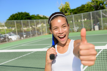 Tennis player woman giving thumbs up happy excited