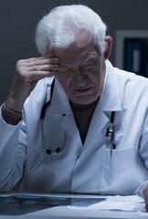 Physician reading x-ray photo