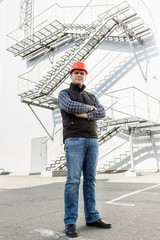 architect posing against metal construction
