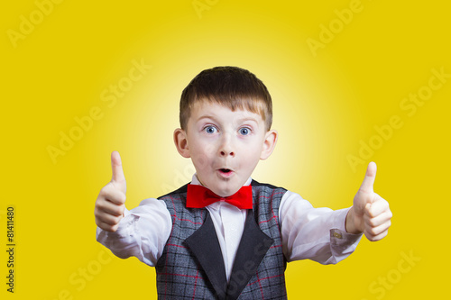 Excited Surprised little boy with thumb up gesture - 81411480
