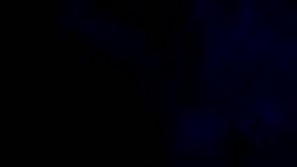 Blue smoke on black isolated