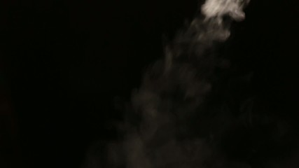 White smoke on black isolated